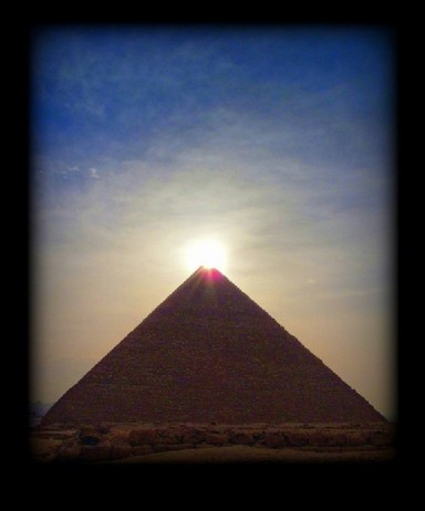 great pyramid giza with sunlight at the top